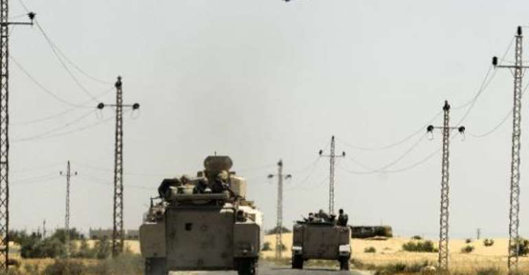 Egyptian soldiers regularly come under attack in the Sinai Peninsuala, where jihadists linked to the Islamic State group are waging a bloody insurgency.  By  (AFP/File)