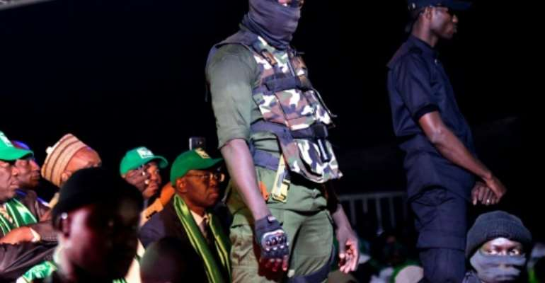 Security agents at a rally staged by Issa Sall in Dakar on February 3.  By SEYLLOU (AFP)