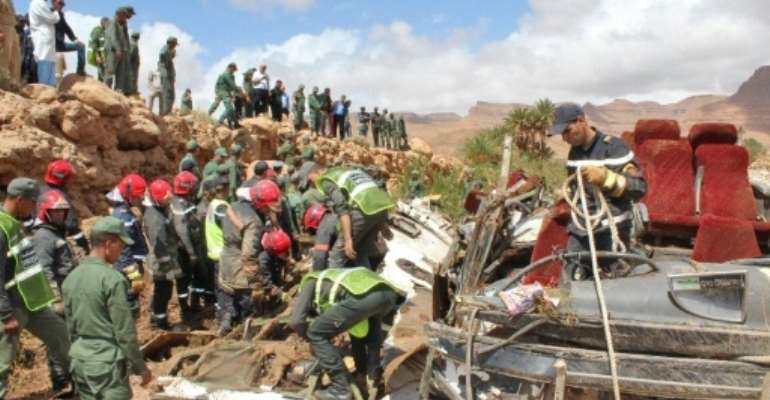 Security forces search the wreckage of a flood-related bus accident in southern Morocco on September 8, 2019.  By - (AFP)