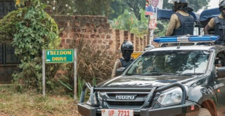Security forces surrounded the home of Ugandan opposition leader Bobi Wine after he returned from voting on January 14.  By SUMY SADURNI (AFP)