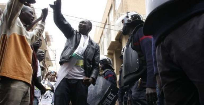 Protesters face off with riot police on February 15.  By Mamadou Toure Behan (AFP/File)