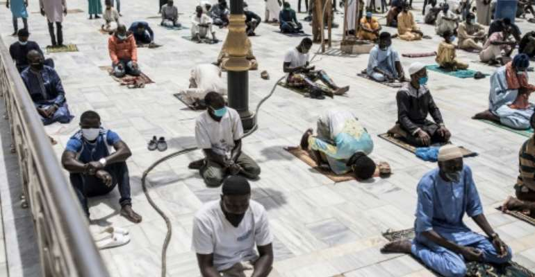 Senegalese Muslim worshippers in Dakar kept up with social distancing practises before Friday prayers.  By JOHN WESSELS (AFP)