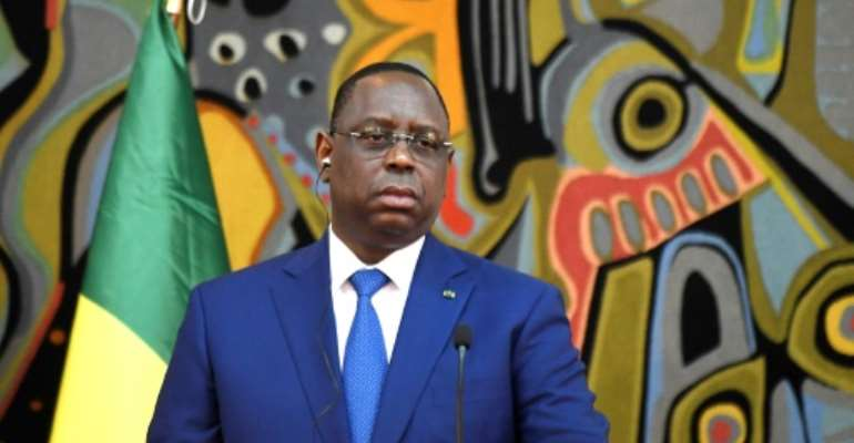 Senegalese President Macky Sall, pictured April 12, 2019, announced the plan to scrap the post of prime minister when he told then-prime minister Mahammad Boun Abdallah Dionne to abolish his own job.  By SEYLLOU (AFP/File)