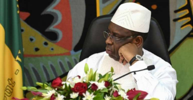 Senegal's President Macky Sall has suggested the BBC report was an attempt to destabilise the country.  By Seyllou (AFP)