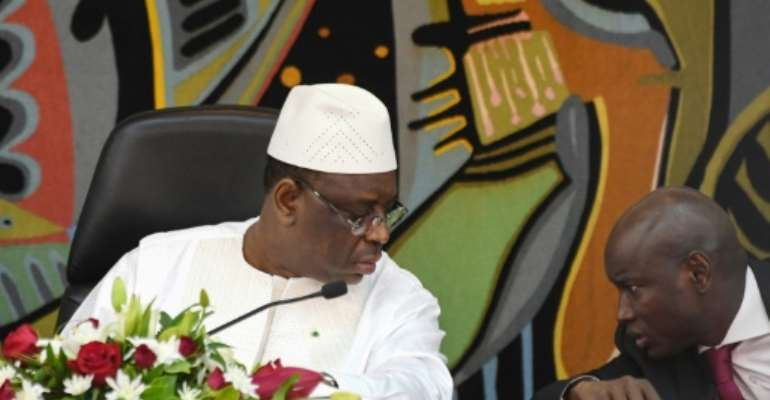 Senegal's President Macky Sall (L) and his Interior minister Aly Ngouille Ndiaye launched a national dialogue project though most opposition parties boycotted.  By Seyllou (AFP)