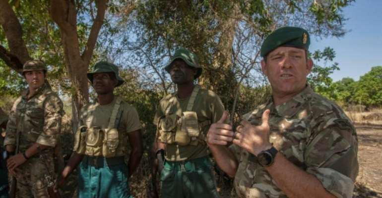 Seven British soldiers are in Malawi to train 35 of the country's anti-poaching rangers.  By Amos Gumulira (AFP)