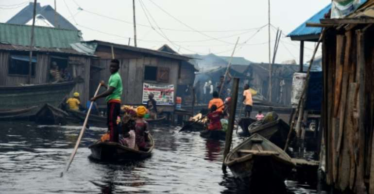 Several hundred thousand people live in Makoko -- a floating slum that officially does not exist.  By PIUS UTOMI EKPEI (AFP)