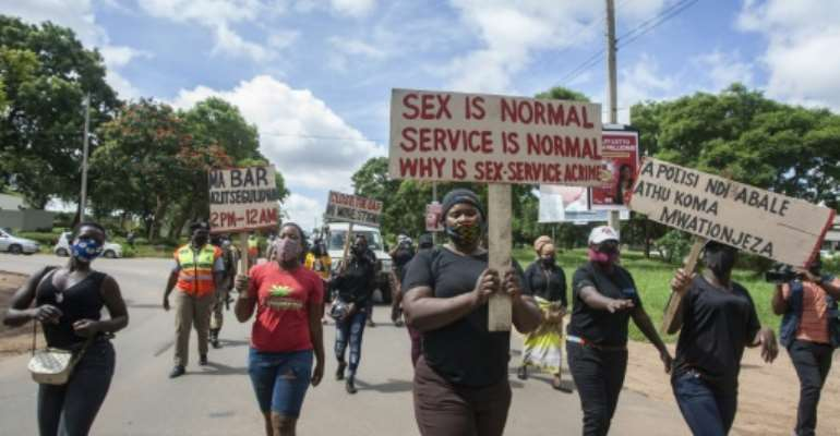 Sex workers in Malawi took part in a protest in January against Covid restrictions.  By AMOS GUMULIRA (AFP)
