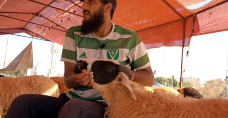 Sheep seller Osama al-Aqury blames soaring fodder prices for the rising cost of meat in Libya.  By Abdullah DOMA (AFP)