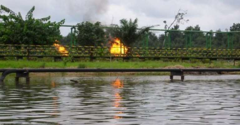 View of an oil plant on the Sambreiro River in the Niger Delta, Nigeria, on September 25, 2005.  By Dave Clark (AFP/File)
