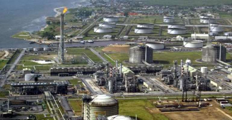 A file picture taken on May 18, 2005 shows a view of oil giant Shell's oil and gas terminal on Bonny Island in southern Nigeria's Niger Delta.  By Pius Utomi Ekpei (AFP/File)