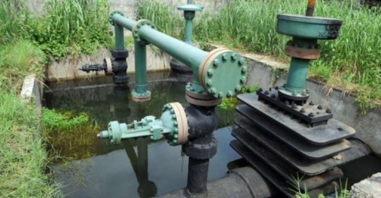 A Shell oil secured inlet manifold is seen in the Niger Delta swamps in 2010.  By Pius Utomi Ekpei (AFP/File)