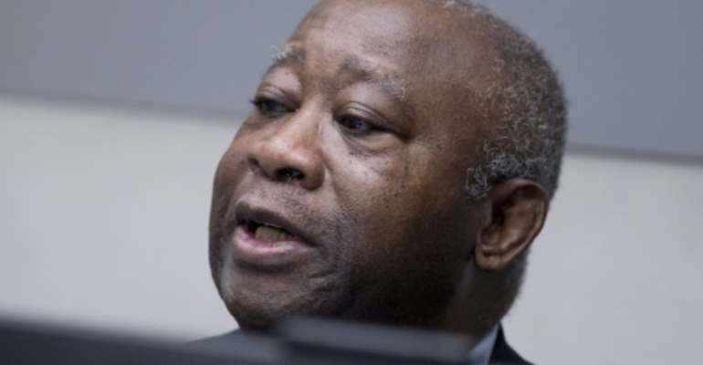 Former Ivory Coast president Laurent Gbagbo before the start of his trial at the International Criminal Court in The Hague on January 28, 2016.  By Peter Dejong (Pool/AFP)