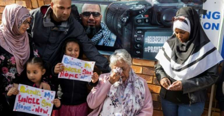 Shiraaz Mohamed's family campaigned for his release on election day last May outside a Johannesburg polling station where President Cyril Ramaphosa was to cast his vote.  By WIKUS DE WET (AFP)
