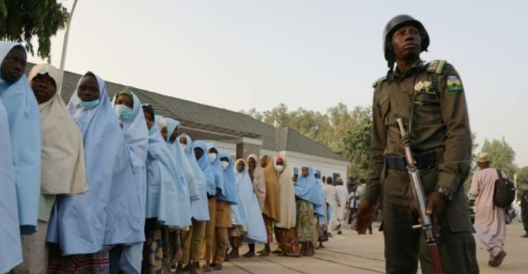 Shooting broke out at a handover ceremony after the kidnapped girls were returned to their village of Jangebe.  By - (AFP)