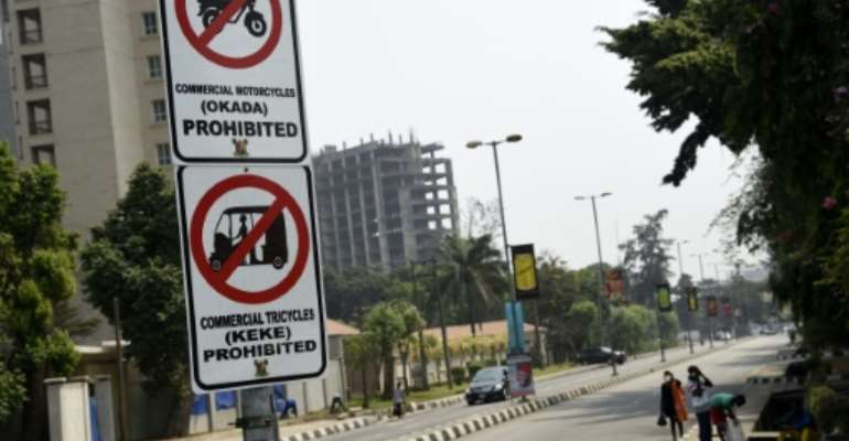 Signs displayed to reinforce a ban on motorbike taxis and motorised rickshaws, known locally as 'okadas' and 'kekes' which has sparked uproar in the Nigerian commercial capital Lagos.  By PIUS UTOMI EKPEI (AFP)