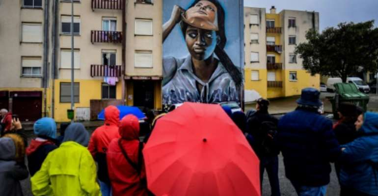 Since the murals went up, a bus line has begun to serve the area, cultural events have multiplied, and the crime rate has fallen.  By PATRICIA DE MELO MOREIRA (AFP/File)