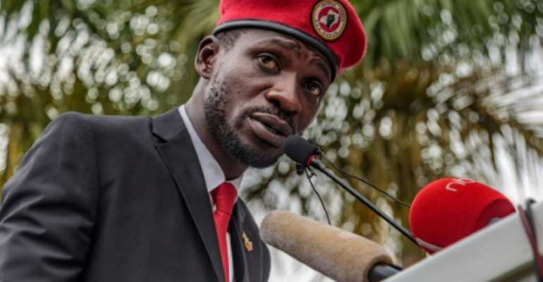Singer turned politician Robert Kyagulanyi, also known as Bobi Wine, has been charged with annoying the president.  By SUMY SADURNI (AFP)