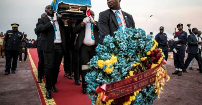 Sixteen months after his death in Belgium, opposition leader Etienne Tshisekedi was buried in his home country, just outside Kinshasa.  By John WESSELS (AFP)