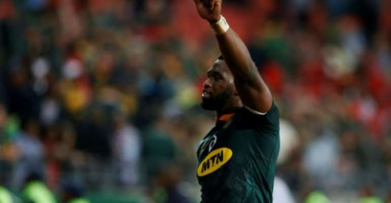 Siya Kolisi South Africa's black captain lifting the Rugby World Cup trophy would be a hugely symbolic moment former Boks assistant coach Alan Solomons told AFP.  By GIANLUIGI GUERCIA (AFP)