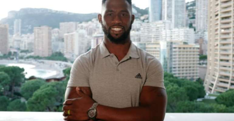 Siya Kolisi was in Monaco to collect a 'Champion of Peace' but looks forward to getting back to training.  By VALERY HACHE (AFP)