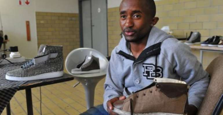 South African Sifiso Dlamini, 24, founder and owner of Eish Hade company, sits at his factory in Johannesburg.  By Alexander Joe (AFP/File)