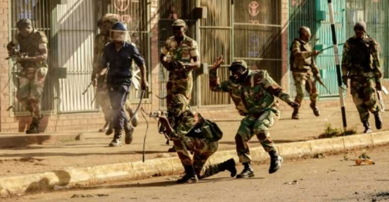 Soldiers fired live ammunition during opposition MDC party protests in downtown Harare, AFP witnesses saw, with one man shot dead in the stomach.  By Zinyange AUNTONY (AFP)