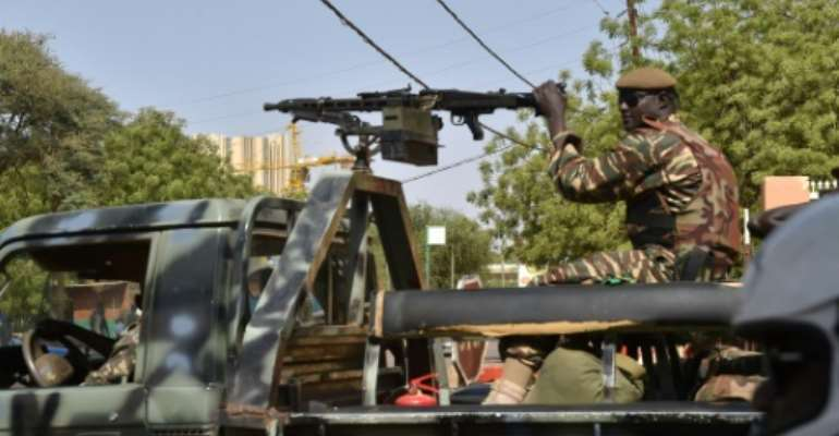 Soldiers on patrol in Niger's capital Niamey.  By ISSOUF SANOGO (AFP)