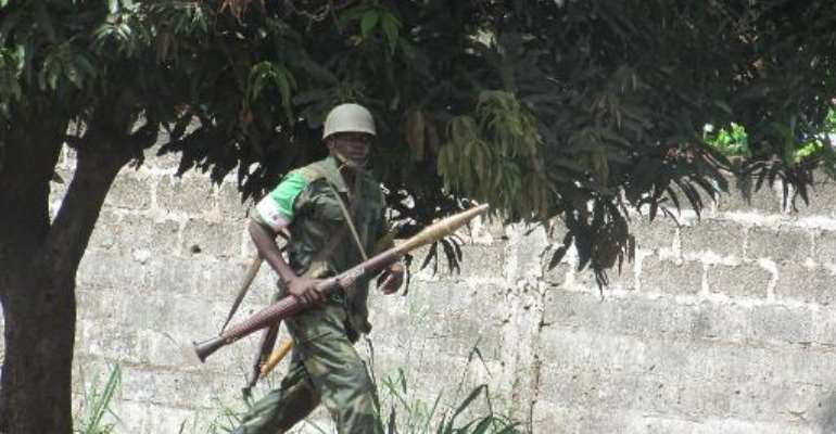 An African Union intervention force (MISCA) holds a rocket launcher as he secures the area during an operation to free the way leading to the north of Bangui on March 25, 2014.  By Pacome Pabamdji (AFP/File)