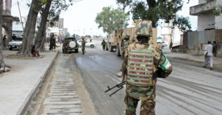 Soldiers of the African Union Mission in Somalia (AMISOM) secure an area near the Godka Jillicow prison in Mogadishu on August 31, 2014.  By Abdifitah Hashi Nor (AFP/File)