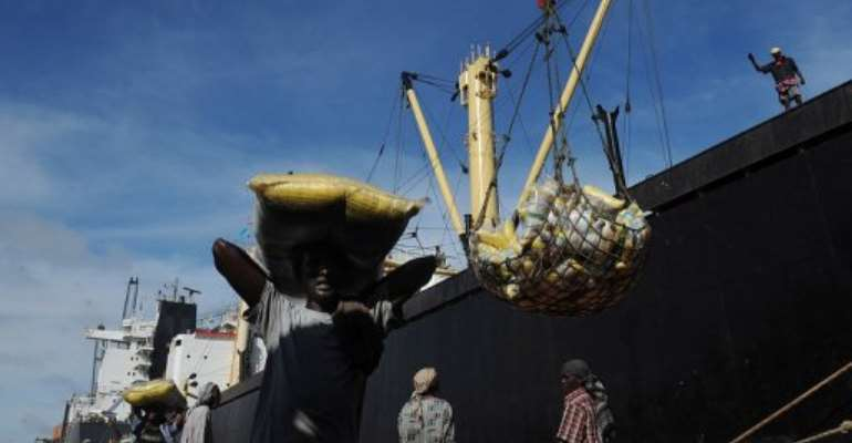 A Somalian porter carries a sack on April 24, 2013 in the sea port in Mogadishu.  By Tony Karumba (AFP/File)