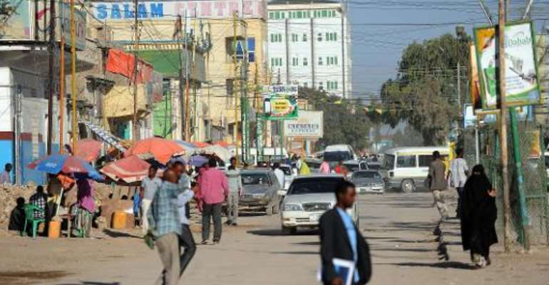 People walk in a street of Somaliland's captal Hargeisa on October 31, 2012.  By Simon Maina (AFP)
