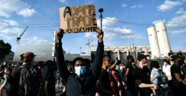 Some 20,000 people protest the 2016 death of a young black man named Adama Traore in French police custody, using slogans echoing those in the demonstrations raging in the US..  By STEPHANE DE SAKUTIN (AFP)