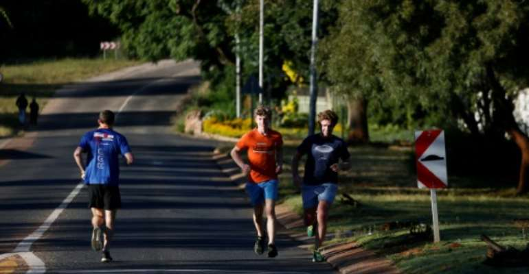 Some outside activities such as cycling, walking and running are allowed, but for just three hours in the morning.  By Phill Magakoe (AFP)
