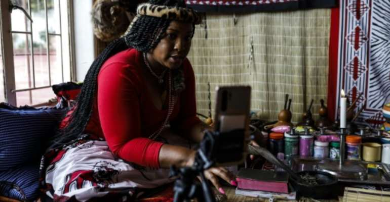 Some traditional healers now find themselves throwing bones in front of an iPhone to maintain a link to their clients.  By Guillem Sartorio (AFP)
