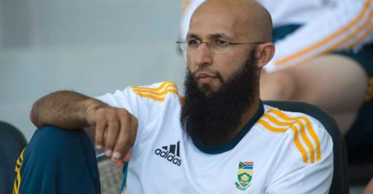 South Africa batsman Hashim Amla watches the team's match against Pakistan on the fourth day of their first Test in Abu Dhabi on October 17, 2013.  By  (AFP/File)