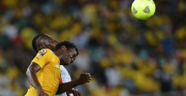 Bongani Khumalo (foreground) heads the ball against Mali in Durban on February 2, 2013.  By Francisco Leong (AFP/File)