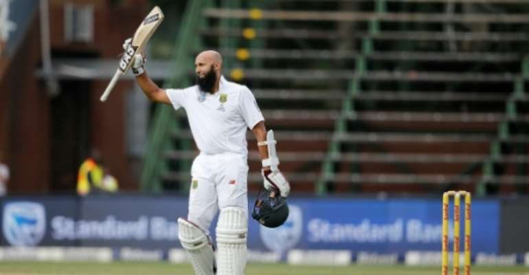 South Africa batsman Hashim Amla celebrates his century in his hundredth Test during the third match against Sri Lanka at Wanderers Cricket Stadium in Johannesburg on January 12, 2017.  By Marco LONGARI (AFP)