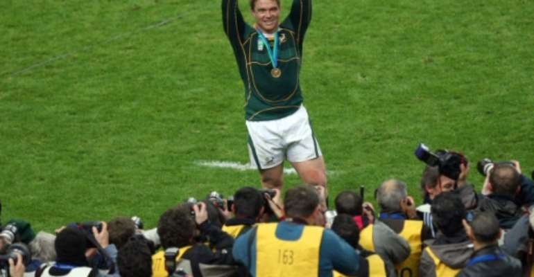 South Africa captain John Smit holds the trophy after a 15-6 victory over England in the 2007 Rugby World Cup final in Paris.  By FRANCK FIFE (AFP)
