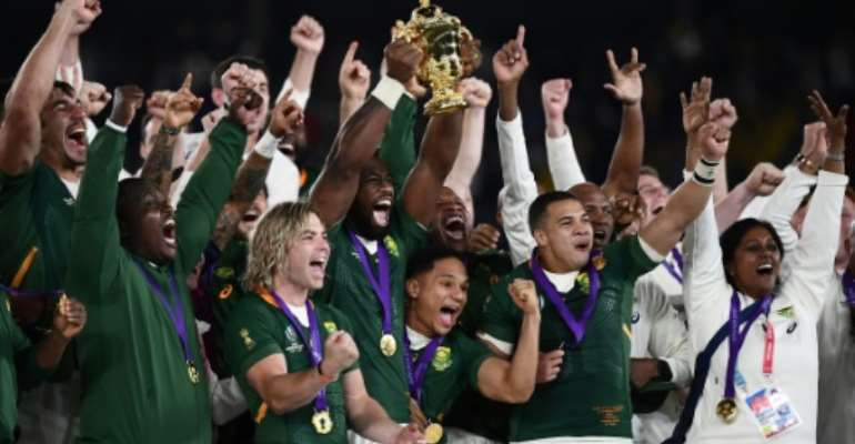 South Africa captain Siya Kolisi lifted the Webb Ellis Cup.  By CHARLY TRIBALLEAU (AFP)