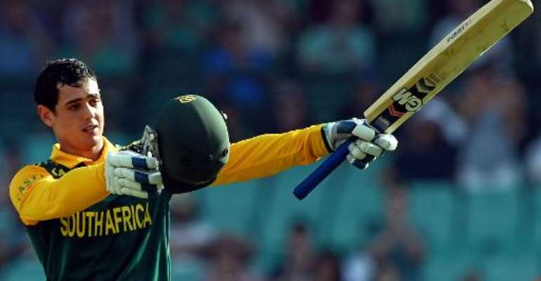 South Africa's batsman Quinton de Kock celebrates his 100 runs against Australia during their fifth one-day international cricket match in Sydney on November 23, 2014.  By Saeed Khan (AFP/File)