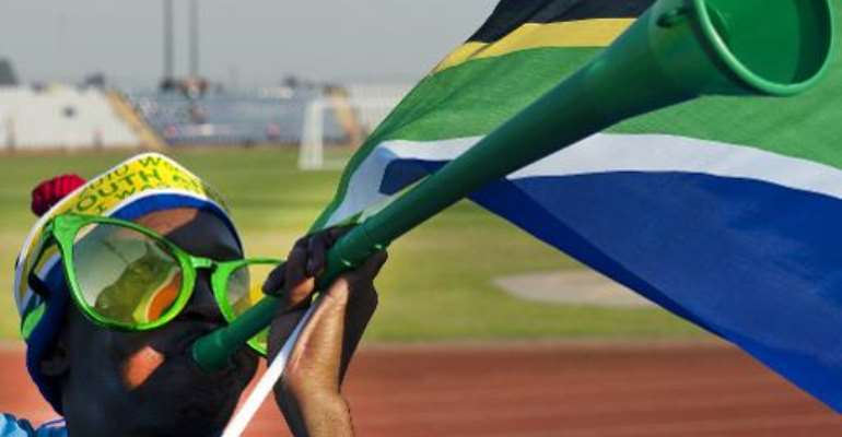 A Soweto resident is seen playing the vuvuzela at Johannesburg's Dobsonville stadium on June 3, 2010 when South Africa was hosting the World Cup.  By Antonio Scorza (AFP/File)