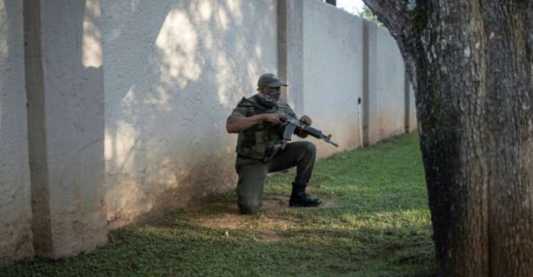 South Africa has one of the world's largest private security industries, employing more personnel than the police.  By Michele Spatari (AFP)