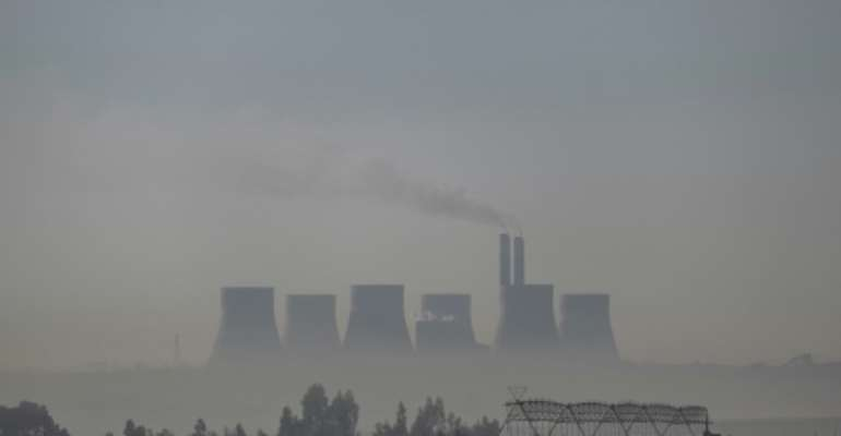 South Africa has placed a big bet on locally-sourced coal to produce electricity, like at the Kendal Power Station, but the nation's power company is initially exempt from the carbon tax.  By Wikus DE WET (AFP/File)