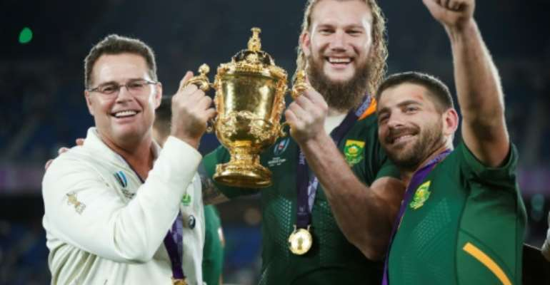 South Africa head coach Rassie Erasmus (L) celebrates with lock RG Snyman (C) and full-back Willie le Roux (R) after winning the 2019 Rugby World Cup final against England in Japan..  By Odd ANDERSEN (AFP)