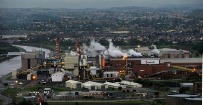 South Africa responds to 'the urgent need for action' with a carbon tax.  By ALEXANDER JOE (AFP)