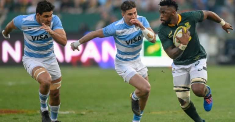 South Africa skipper Siya Kolisi (R) outpaces two Argentines during a Rugby World Cup warm-up match in Pretoria last month.  By Christiaan Kotze (AFP)