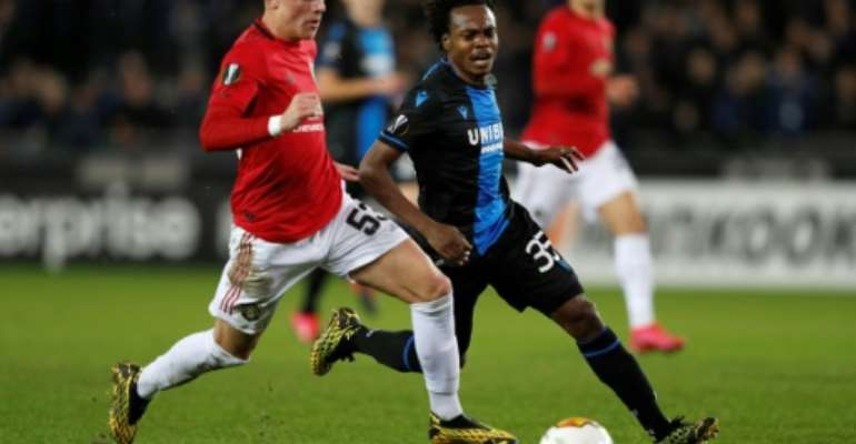 South Africa star Percy Tau (C) playing for Bruges against Manchester United this year in the Champions League.  By Adrian DENNIS (AFP)