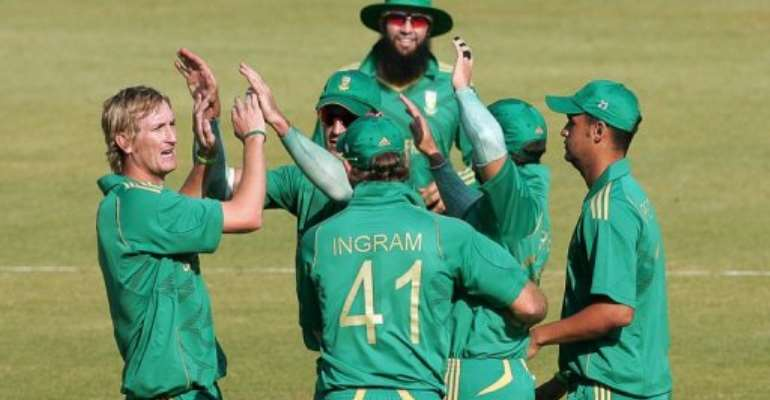 South Africans celebrate a wicket against Zimbabwe at the weekend.  By Jekesai Njikizana (AFP/File)