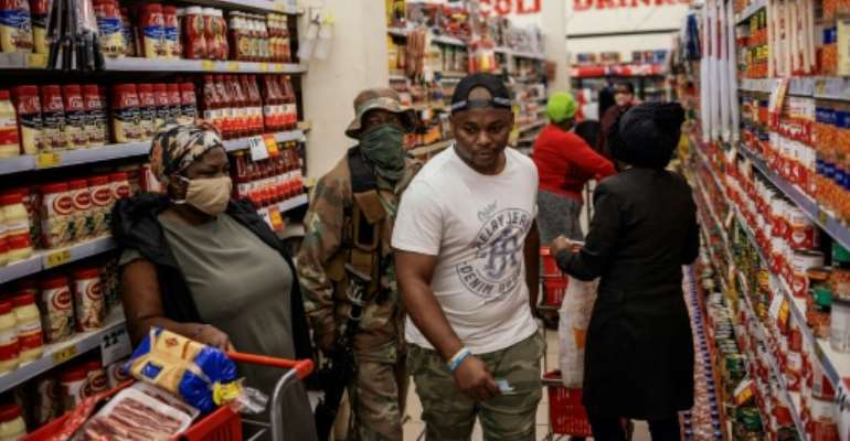 South Africa went into strict lockdown at the end of March, with people only allowed to shop for essential items such as food, medicine and winter clothing.  By Michele Spatari (AFP/File)